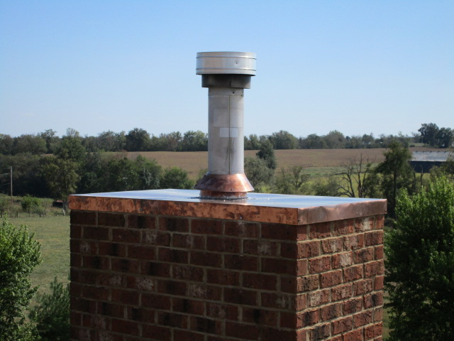 Chimney cap replaced with a new Copper cap. Everything was soldered together.